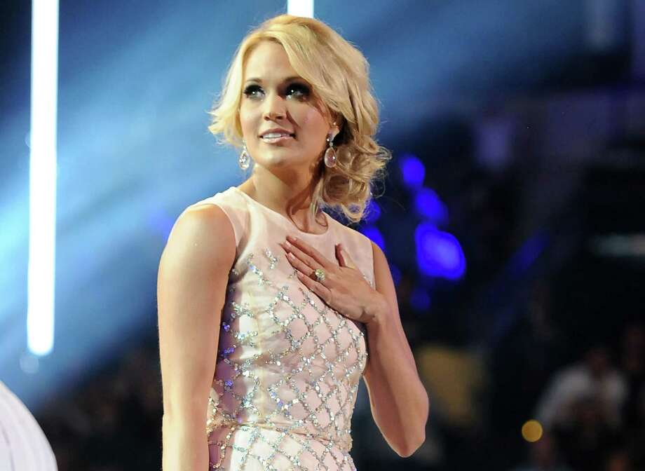FILE - This June 5, 2013 file photo shows Carrie Underwood at the 2013 CMT Music Awards at Bridgestone Arena in Nashville, Tenn. Underwood will perform at the awards ceremony as part of a tribute to TV's role in significant 1960s events. The Emmys will air at Sunday at 8 p.m. EDT on CBS. (Photo by Frank Micelotta/Invision/AP, File) ORG XMIT: NYET330 Photo: Frank Micelotta / Invision