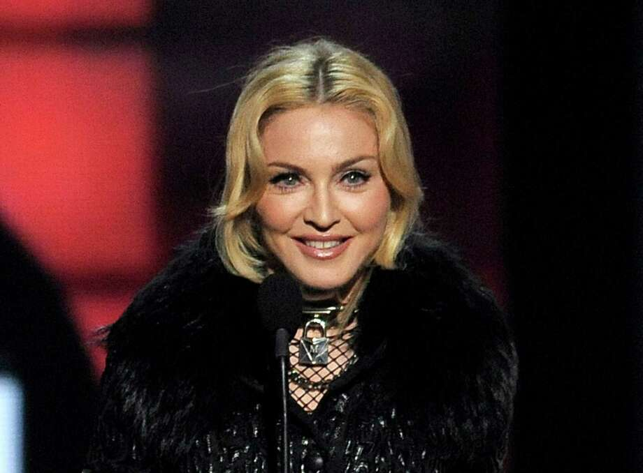 FILE - In this May 19, 2013 file photo, Madonna accepts the award for top touring artist at the Billboard Music Awards in Las Vegas. A minor tempest over an access road built on Madonna's Hamptons horse farm appears to have been settled. Newsday reports that Suffolk County officials sent Madonna a cease-and-desist letter. It said her 24-acre Bridgehampton property was improperly being used as a cut-through for construction vehicles to get to her adjacent land. (Photo by Chris Pizzello/Invision/AP, File) ORG XMIT: NYET318 Photo: Chris Pizzello / Invision