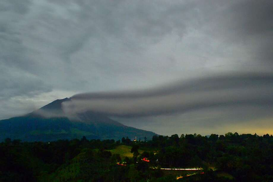 Pardon the eruption: The Mt. Sinabung Volcano burps steam and ash at dawn Wednesday on Sumatra after erupting 