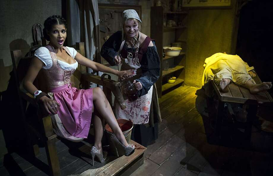 What have you done to Hansel? German model Micaela Schaefer is held captive by a witch during a pre-Oktoberfest promotion for the Berlin Dungeon, a house-of-horrors-style attraction in Berlin. Photo: Johannes Eisele, AFP/Getty Images
