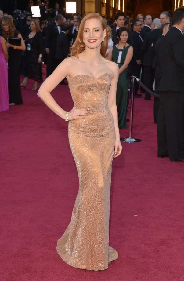 Actress Jessica Chastain, wearing Giorgio Armani, arrives at the Oscars at Hollywood & Highland Center on February 24, 2013 in Hollywood, California.  (Photo by Lester Cohen/WireImage) Photo: Lester Cohen, WireImage