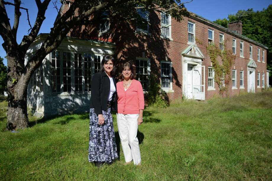 Donna DeLuca, left, and Dorrie Carolan, founders and directors of the Newtown Parent Connection, plan to renovate this building on the Fairfield Hills campus in Newtown, Conn. to expand their organization that helps parents coping with adolescent substance abuse and addiction issues. Photo: Tyler Sizemore / The News-Times