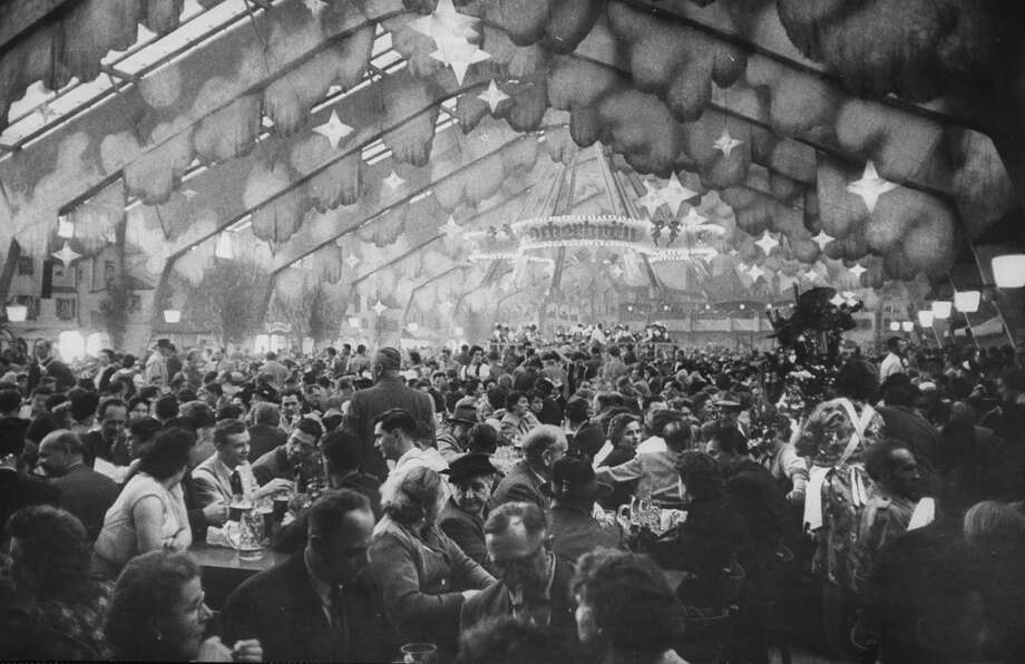 During Octoberfest, everybody drinking beer, singing, dancing, huge tents setup for drinking. Photo: Frank Scherschel, Getty Images / Time Life Pictures