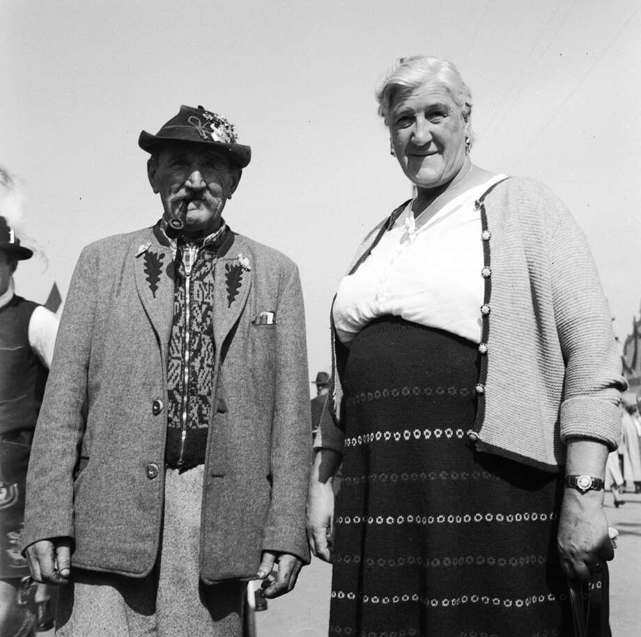 A farmer and his wife from a quiet mountain village. They have saved all year, and are now determined to have a good time spending all their savings at the Munich Oktoberfest. Photo: Three Lions, Getty Images / Hulton Archive