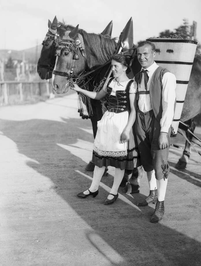 A couple in national costume at the great 'Oktoberfest' in Munich, Germany. Photo: Fox Photos, Getty Images / Hulton Archive