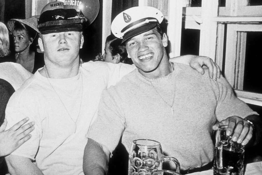 Arnold Schwarzenegger and friend enjoy Oktoberfest in 1967. Photo: Getty Images