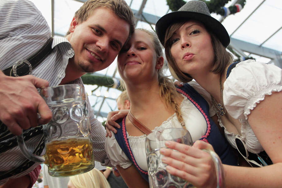 Revellers cheer with beer mugs inside Schottenhamel beer tent during the last day of Oktoberfest beer festival on October 3, 2011 in Munich, Germany. Photo: Johannes Simon, Getty Images / 2011 Getty Images