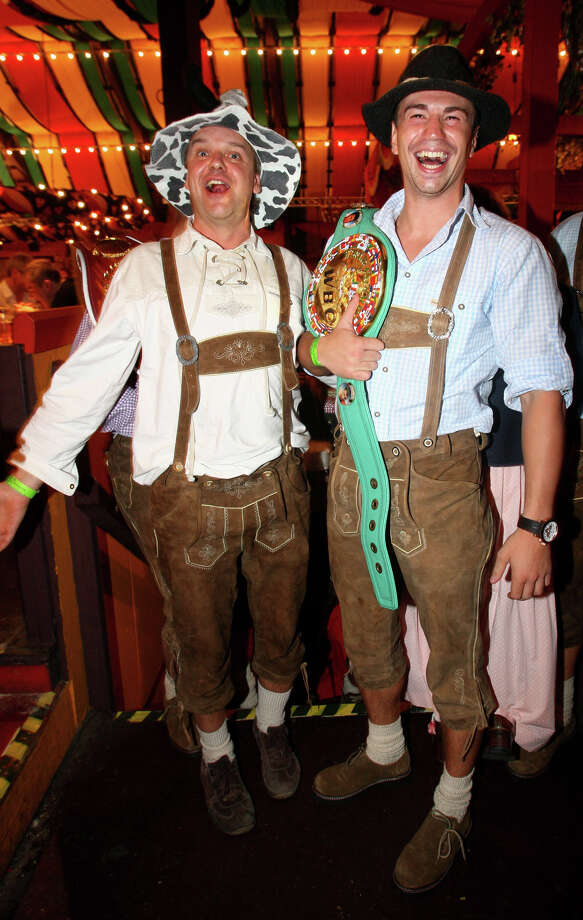 WBC Interim Middleweight World Championship Sebastian Zbik (R) and a visitor of the Oktoberfest pose for a picture at the Hippodrom beer tent on Sept. 30, 2009 in Munich, Germany. Photo: Miguel Villagran, Getty Images / 2009 Getty Images