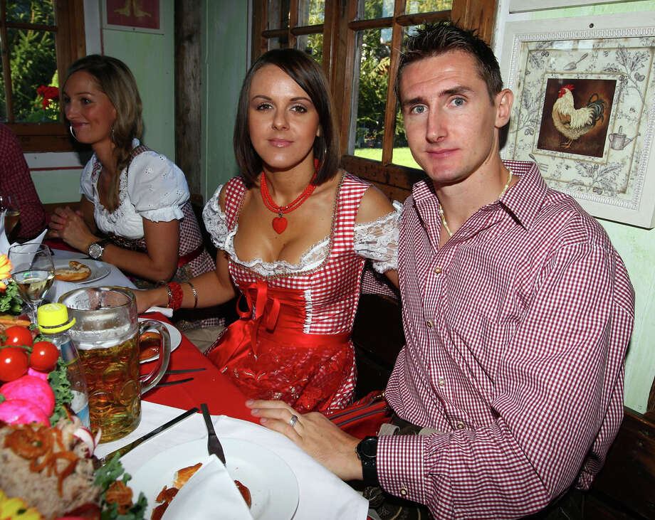Miroslav Klose of Bayern Muenchen and his wife Sylwia attend the Kaefer beer tent during the Oktoberfest beer festival on Oct. 5, 2008 in Munich, Germany. Photo: Johannes Simon, Getty Images / 2008 Getty Images