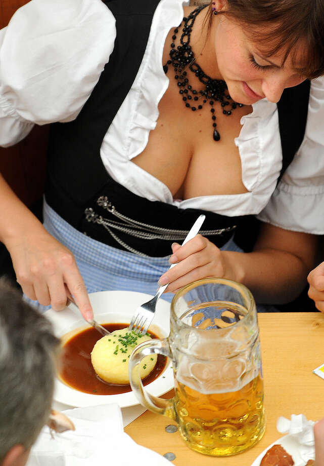 A woman has a meal with dumplings and beer on the second day of the Oktoberfest beer festival on Sept. 20, 2009. Photo: JOE KLAMAR, Getty Images / 2009 AFP