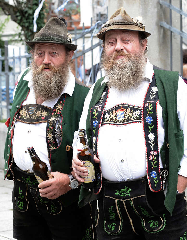 German twin brothers in traditional clothes watch the marksmen's parade on the second day of the Oktoberfest beer festival on Sept 20, 2009. Photo: JOE KLAMAR, Getty Images / 2009 AFP