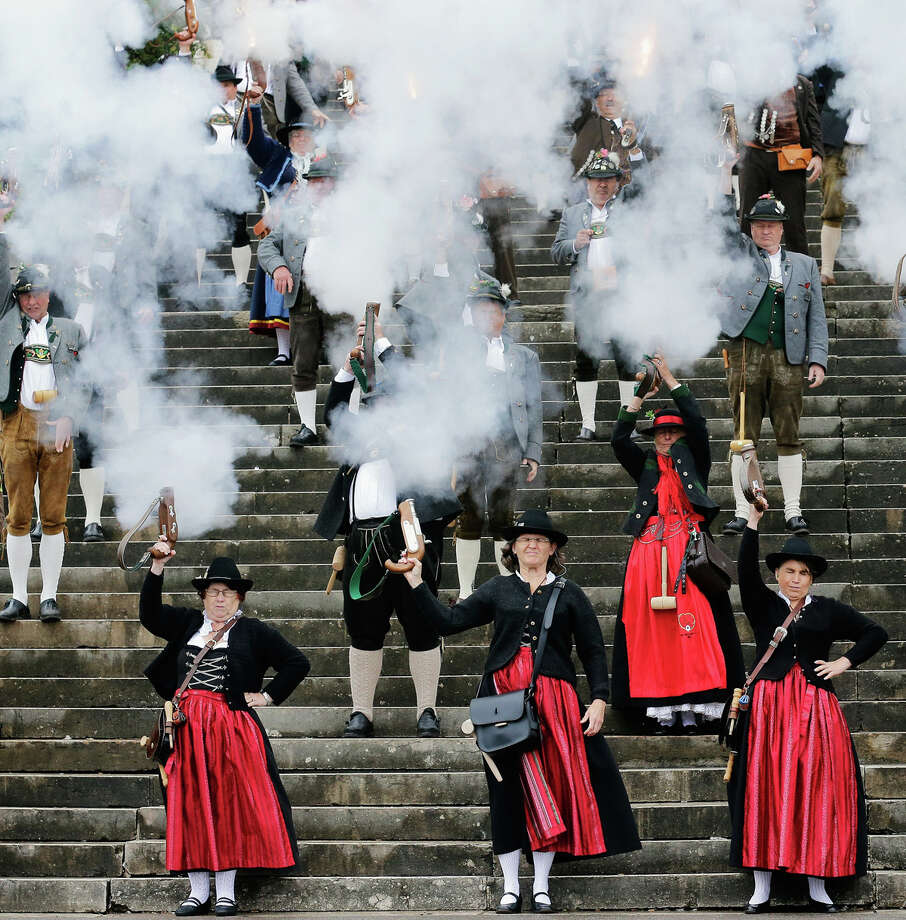 Members of a Bavarian riflemen's association fire a shoot during the traditional 'Boellerschiessen' (firing of a salute with a special gun) on the last day of Oktoberfest beer festival on October 7, 2012 in Munich, Germany. The 'Boellerschiessen' officially signifies the closing of this year's edition of the world's biggest beer festival. Photo: Johannes Simon, Getty Images / 2012 Getty Images