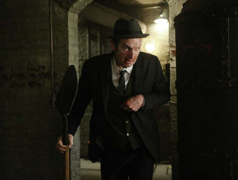 No one wields a shovel like Denis O'Hare in American Horror Story (Season 1).  Photo: FX