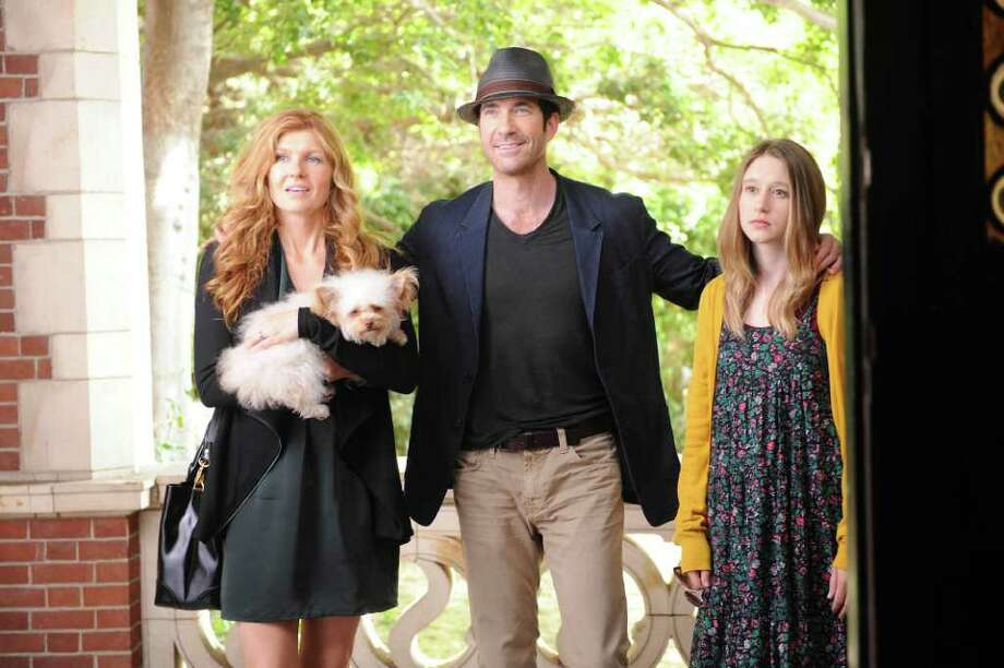 Dylan McDermott, center, also starred in American Horror Story: Murder House, with Connie Britton, left, and Taissa Farmiga, as Violet.  Photo: FX
