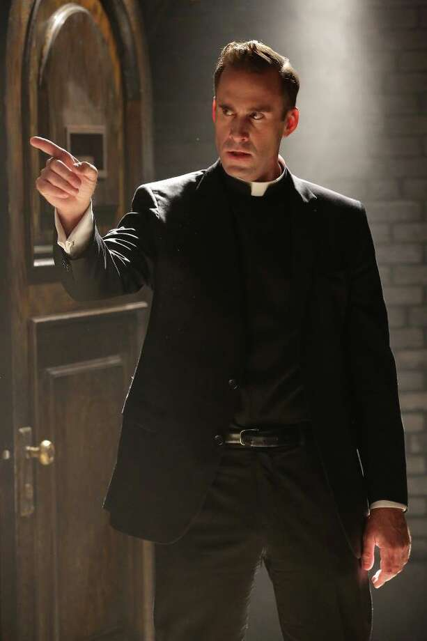 Joseph Fiennes as Monsignor Timothy Howard in American Horror Story: Asylum. Photo: FX
