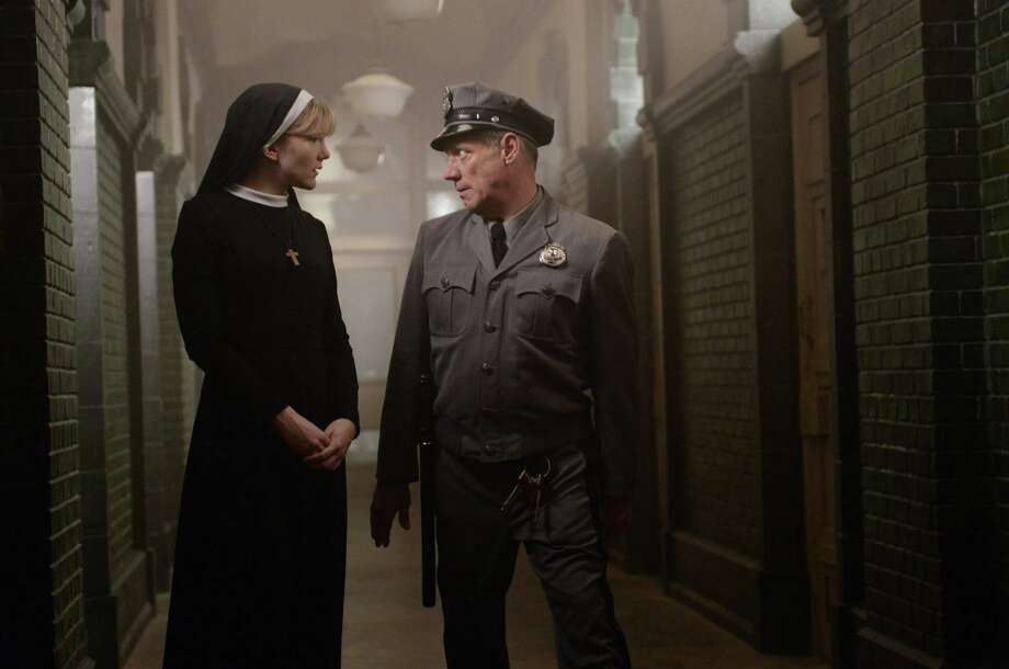 Fredric Lehne, as Frank, right, and Lily Rabe, as Sister Mary Eunice, in  American Horror Story: Asylum.  Photo: FX