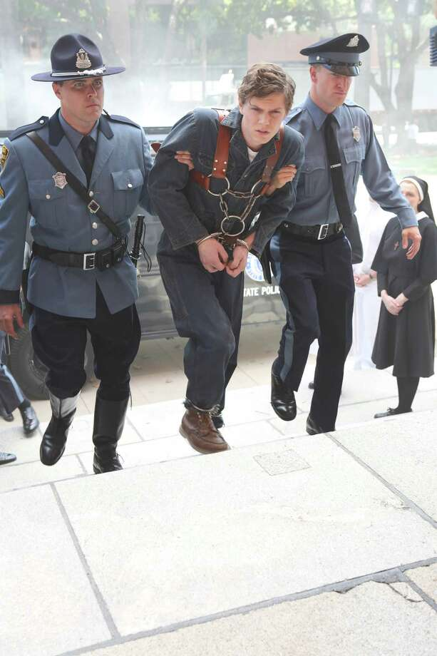 Evan Peters (center) as Kit, in American Horror Story: Asylum.  Photo: FX