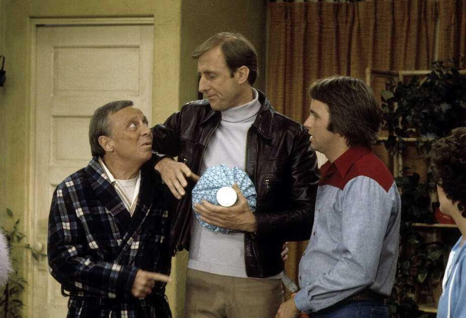 James Cromwell, center, got his start in the '70s, by guest-starring in TV shows like Barney Miller, All in the Family and Three's Company, pictured. The episode is from 1977 with Norman Fell, left, and John Ritter, right. Photo: ABC Photo Archives, Getty Images / 2010 American Broadcasting Companies, Inc.