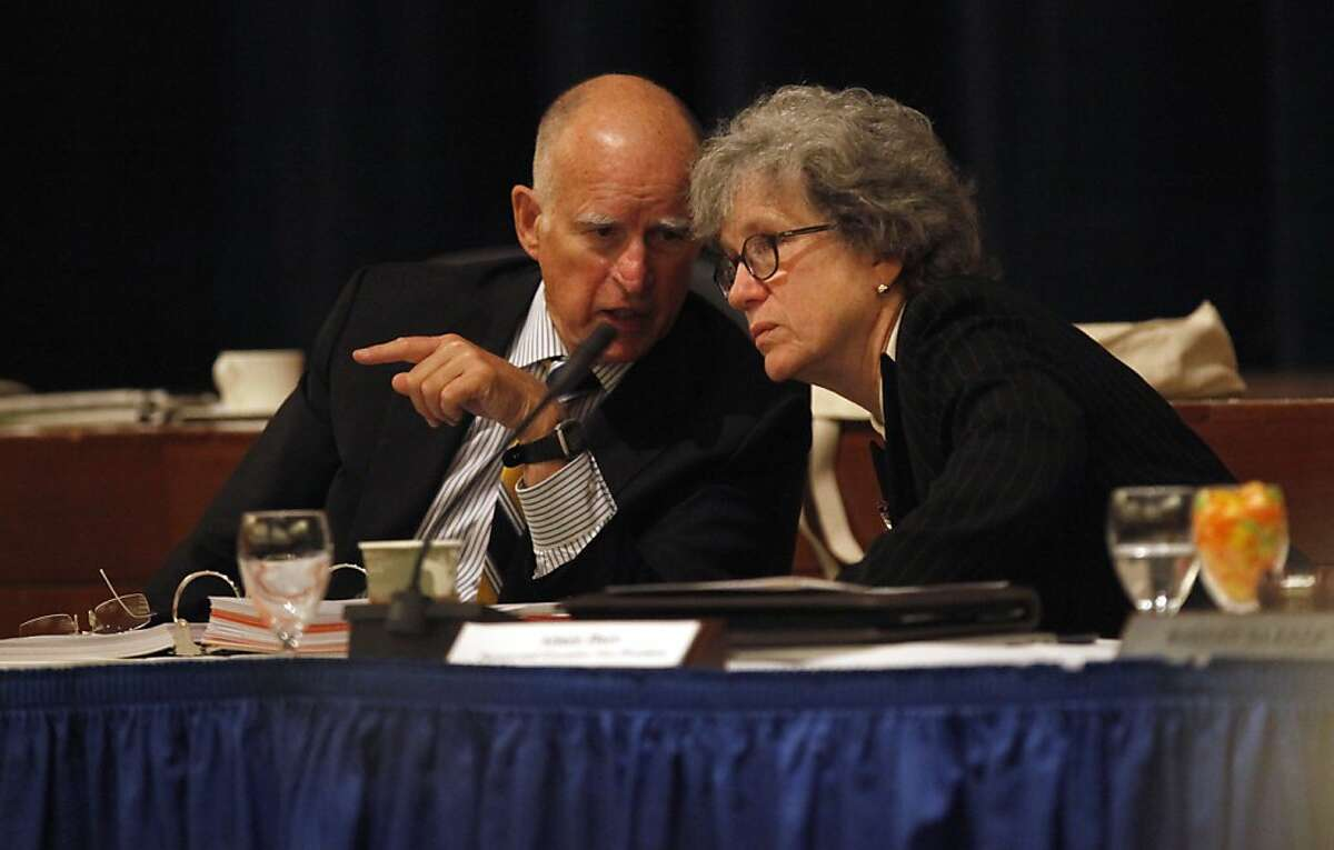 Gov. Jerry Brown talks with Aimee Dorr , Provost and Executive Vice President for academic affairs, as they sits among the UC Regents for the launch a of social media campaign to raise scholarship funds, Wednesday September 18, 2013, in San Francisco, Calif. Promise for Education is a six week crowd funding campaign that engages students, faculty, alumni, celebrities, businesses politicians and supporters in raising money for UC student scholarships.