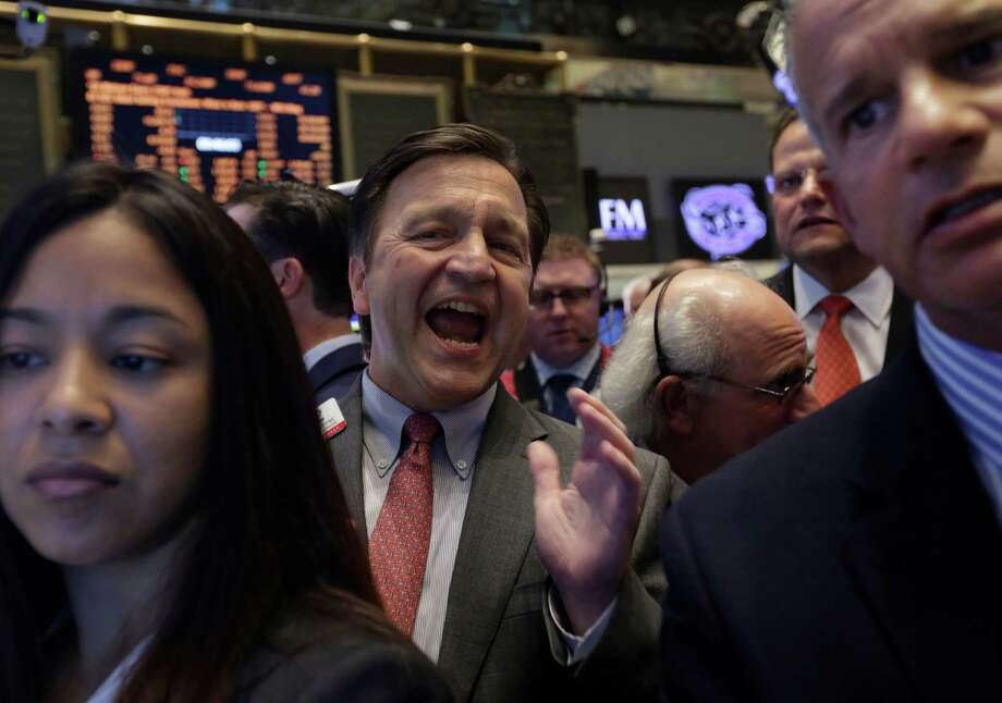 Richard Drew / Associated Press The floor of the New York Stock Exchange gets load as stocks fell Monday as the threat of a government shutdown looms. Photo: Richard Drew / AP