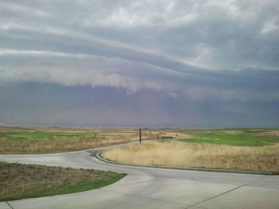 "The Eastern Washington haboob gathers steam on Sunday, Sept. 15, 2013, as seen from the Wine Valley Golf Club in Walla Walla, Wash. ""We have GPS systems on our carts that allow us to send messages to 