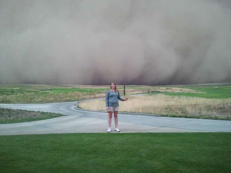 """The Eastern Washington haboob approaches on Sunday, Sept. 15, 2013, as seen from the Wine Valley Golf Club in Walla Walla, Wash.    """"We have GPS systems on our carts that allow us to send messages to anyone on the course, so I sent them a message that dangerous weather was approaching, """"Please return to the club house!""""     Check out the rest of Cory Spencer's first-person account of the attack of the haboob. (Photo: Cory Spencer/Wine Valley Golf Club in Walla Walla, Wash., and on Facebook.) Photo: Multiple"""
