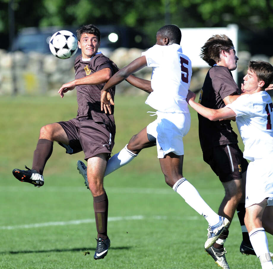 Brunswick's Sebastian Foster, left, goes for the ball against Prosper Figbe (# 5) of Loomis Chaffee during the soccer match between Brunswick School and Loomis Chaffee School at Brunswick in Greenwich, Wednesday, Sept. 18, 2013. Photo: Bob Luckey / Greenwich Time