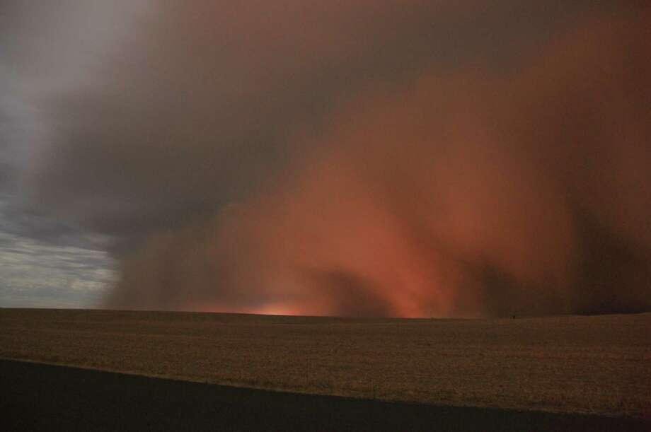 """The Eastern Washington haboob storms onward as seen from about 15 miles south of Spokane down Highway 195, close to the town of Spangle on Sunday, Sept. 15, 2013. """"My adrenaline was pumping; I was all alone on the side of a road; complete silence, calm winds, and a wall rapidly getting closer and closer. According to my iPhone app, I had just a few minutes before the wind and dust would hit.""""  Check out the rest of Andrew Brown's first-person account.  (Photo: Andrew Brown, Warning Coordination Meteorologist, National Weather Service Forecast Office, Spokane, Wash.) Photo: Multiple"""
