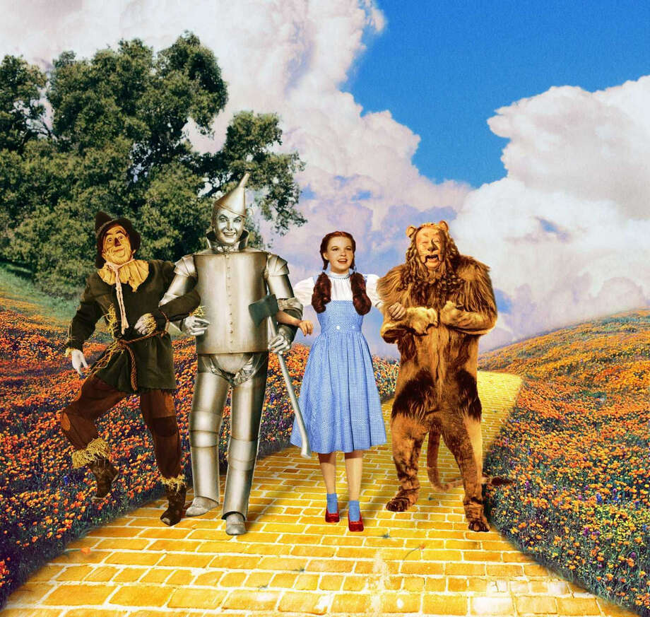 "Scarecrow (Ray Bolger), Tin Man (Jack Haley), Dorothy (Judy Garland), Cowardly Lion (Bert Lahr) walk down the Yellow Brick Road in ""The Wizard of Oz,"" being ressiued in a 3-D IMAX version Friday. Photo: Courtesy Turner Classic Movies"
