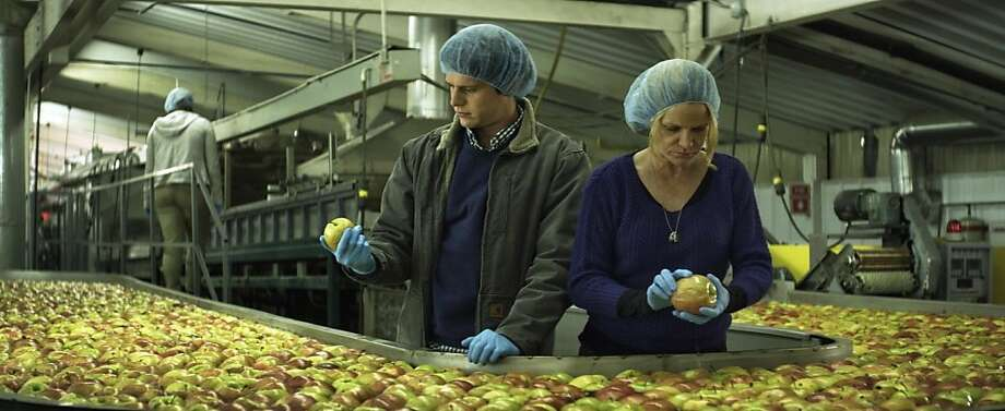 "Jonathan Groff and Dale Dickey work on an apple farm in ""C.O.G."" The film is based on an autobiographical short story by David Sedaris. Photo: Focus World"