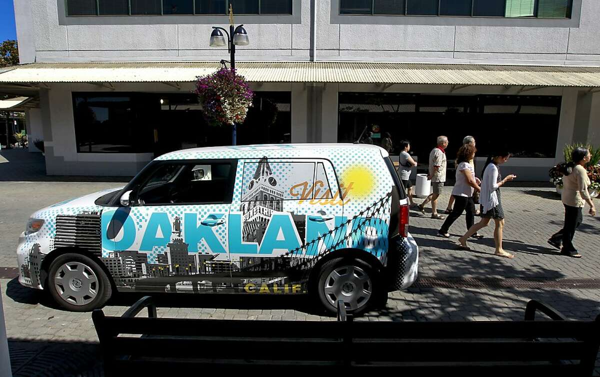 A new mobile outreach vehicle, designed by the local business Oaklandish, is parked in front of the Visit Oakland Center, on Tuesday Sept. 17, 2013, at Jack London Square in Oakland, Calif. The center has plans of driving the vehicle to Santa Monica this weekend to market the City of Oakland. The City of Oakland is renewing it's push to convince tourists that the city is safe by opening a visitors center designed to encourage people to visit.