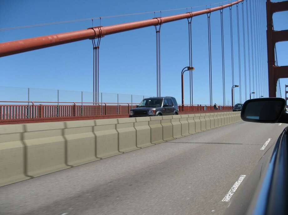 A digitally enhanced photograph shows details of what the Golden Gate Bridge District's proposed moveable lane barrier would look like when installed between the span's northbound and southbound lanes. The safety measure to prevent head-on crashes has been in the works for years and officials now say it will be installed in early 2015. Photo: HO