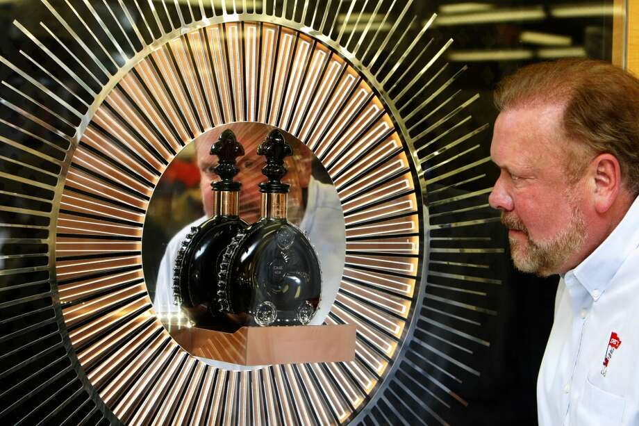 Spec's CEO John Rydman looks at a decanter of Louis XIII Rare Cask 42,6 in its display case at the Spec's superstore, 2410 Smith, near downtown.The limited-release cognac will sell for $22,000 per bottle. Photo: Cody Duty, Houston Chronicle