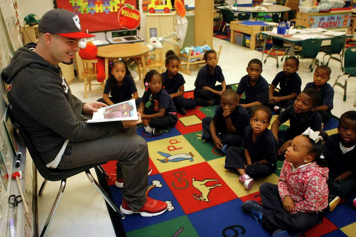 Houston area rapper Paul Wall smiles as a student tells him that her