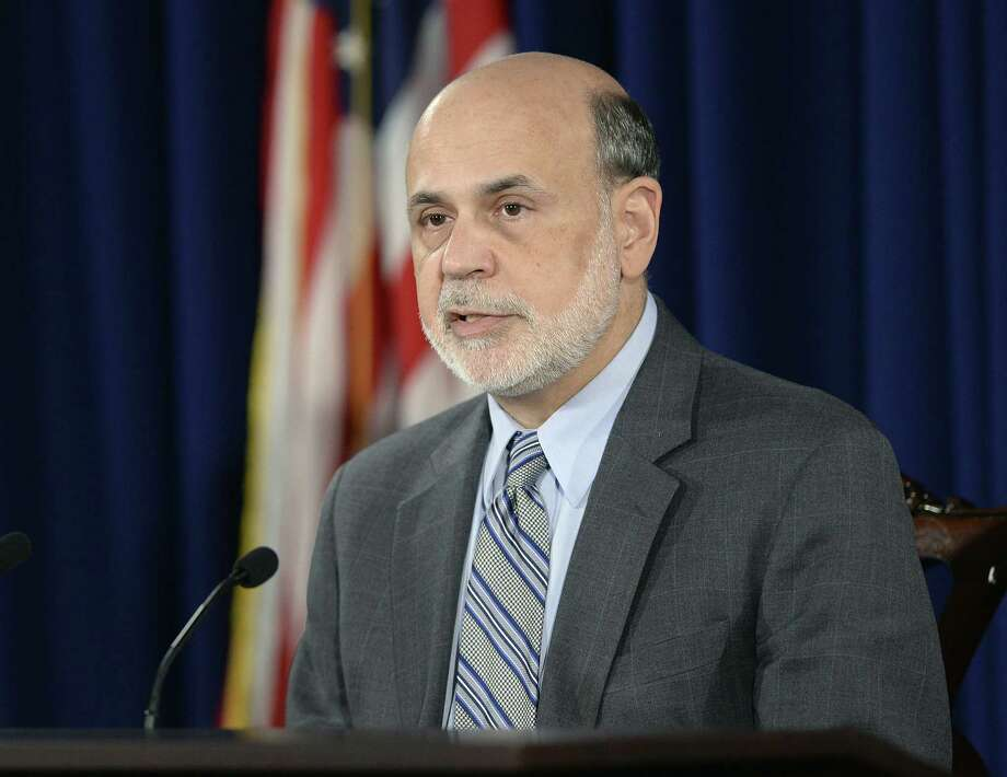Federal Reserve Chairman Ben Bernanke speaks during a news conference at the Federal Reserve in Washington, Wednesday, Sept. 18, 2013. The Federal Reserve decided against reducing its stimulus for the U.S. economy, saying it will continue to buy $85 billion a month in bonds because it thinks the economy still needs the support. (AP Photo/Susan Walsh) ORG XMIT: DCSW101 Photo: Susan Walsh / AP