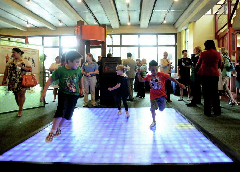 Children play at the Witte Museum during a reveal of plans for the $5 million H-E-B Body Adventure center. Photo: Billy Calzada, San Antonio Express-News / San Antonio Express-News