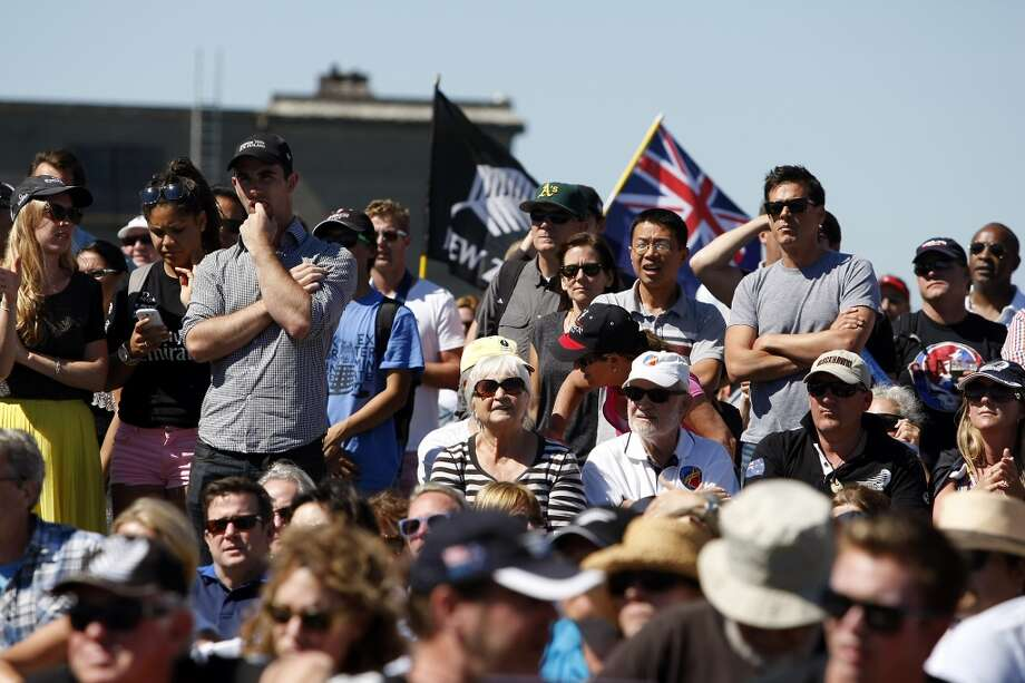 Fans at America's Cup Pavilion watch a big screen to find out if race number twelve of the America's Cup Finals will be canceled due to wind limits, in San Francisco, California Wednesday, September 18, 2013. Photo: Michael Short, The Chronicle