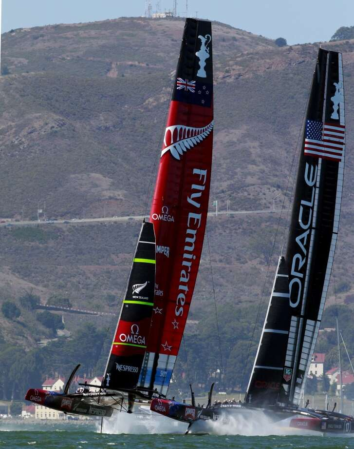 Oracle Team USA and Emirates Team New Zealand battle for position at the start of Race 11 of the America's Cup Finals on Wednesday, September 18, 2013 in San Francisco, Calif. Photo: Beck Diefenbach, Special To The Chronicle