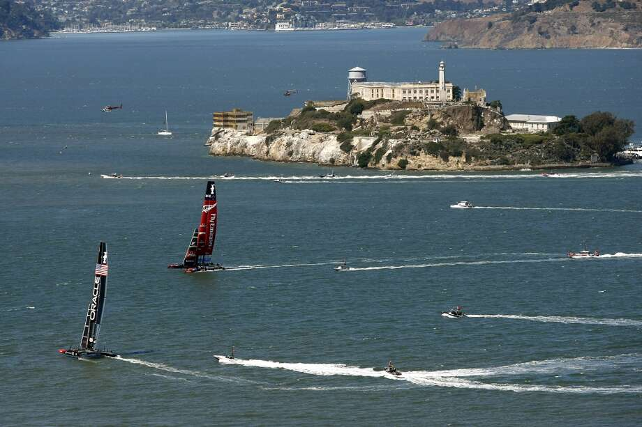 Emirates Team New Zealand and Oracle Team USA pass by Alcatraz Island as they tack upwind during race number eleven of the America's Cup Finals in San Francisco, California Wednesday, September 18, 2013. Photo: Michael Short, The Chronicle