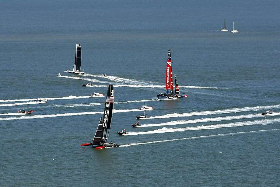 The AC72s maneuver before the start of Race 11 on San Francisco Bay. The Kiwis would win a closely contested race to move one win shy of taking the Cup, but wind postponed Race 12. Photo: Michael Short, The Chronicle