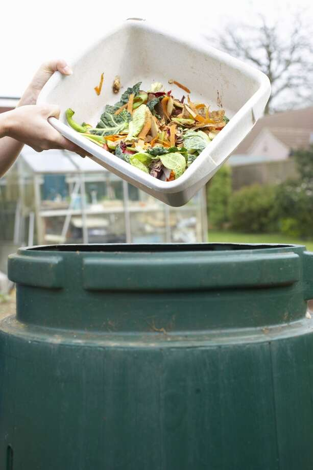 Turn food scraps into compost instead of throwing them into the trash can. Photo: Martin Poole, Getty Images