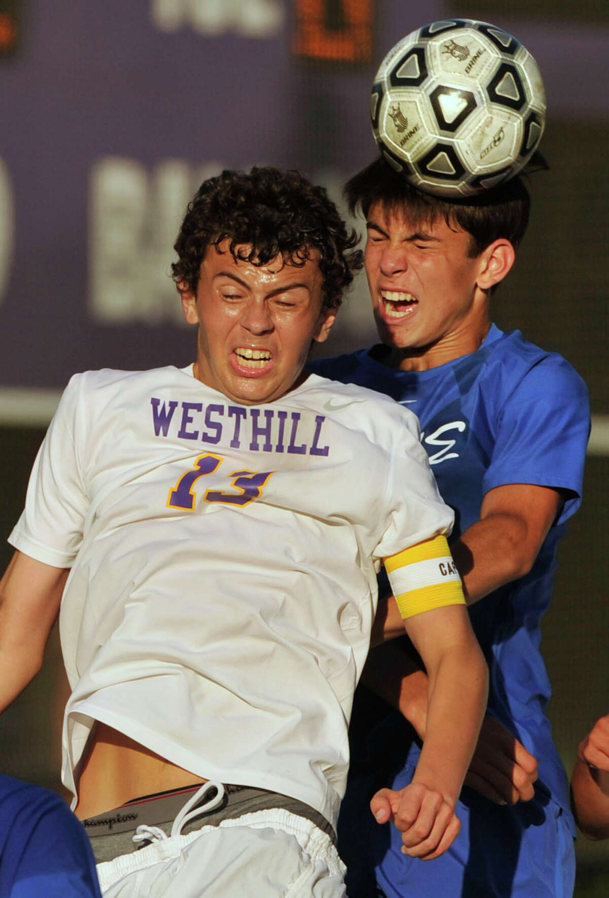 Westhill's Ian Zacharewicz and Darien's Andrew Mathew compete for a header during their game at Westhill High School in Stamford, Conn., on Wednesday, Sept. 18, 2013. Westhill beat Darien, 4-1.