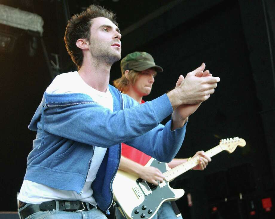 Adam Levine, left, in his hard-rocking, hoodie days of 2003, singing with Maroon 5 in Englewood, Colorado. Photo: Tim Mosenfelder, Getty Images / 2003 Getty Images