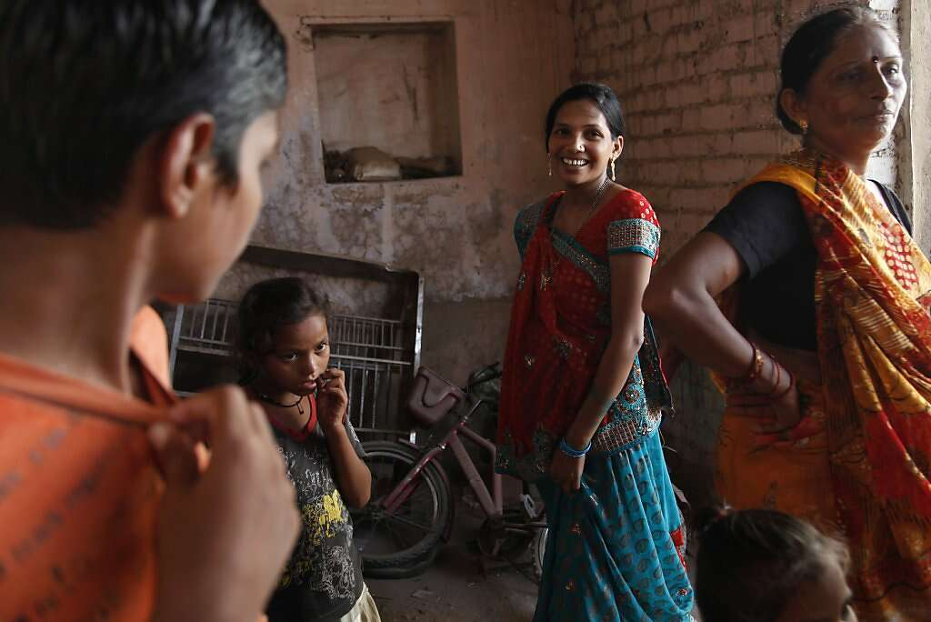 Manisha Parmar receives a chilly home coming in Khambhat, India, Monday, June 3, 2013. Surrogacy is culturally stigmatized in her community, although several other women in the area became surrogates before Manisha. Photo: Nicole Fruge, The Chronicle
