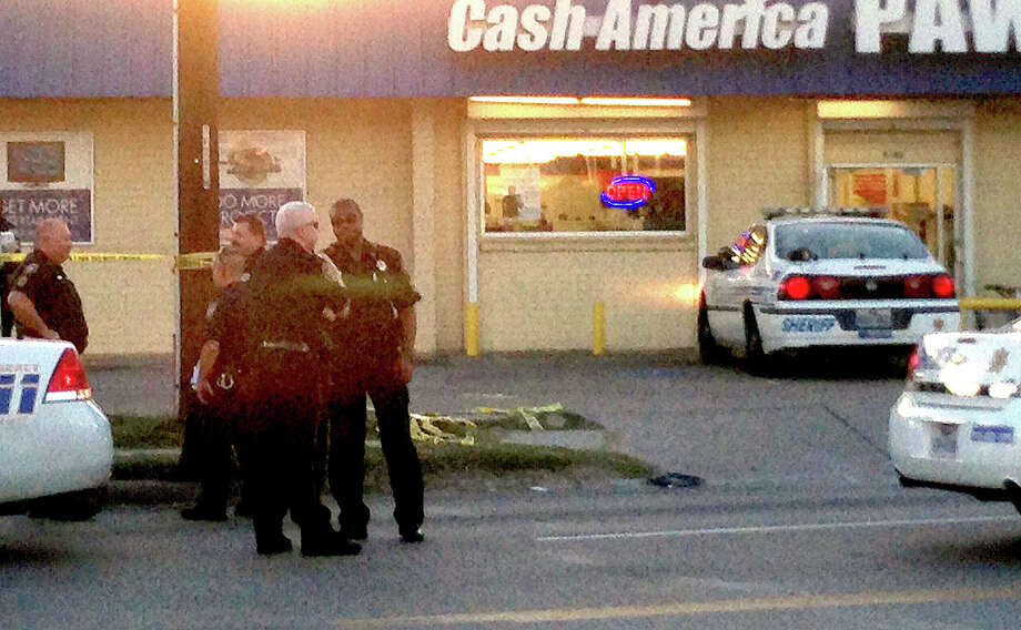 The suspect was shot at Cash America Houston, in the 9800 block of Airline, on Wednesday evening. (Mike Glenn/Chronicle)