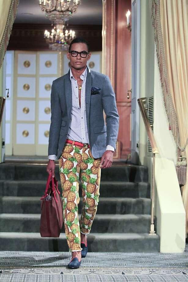 A gray jacket dresses up pineapple- print pants and a half-open shirt at Michael Bastian's show. Photo: Rahav Segev, New York Times