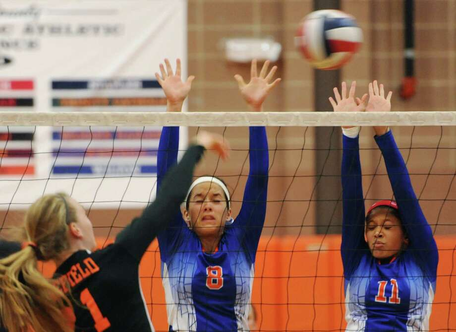 Danbury's Kate Felmeth (8) and Jocelyn Perez (11) go up for a block in the girls volleyball match between Danbury and Ridgefield at Ridgefield High School in Ridgefield, Conn. on Wednesday, Sept. 18, 2013.  Ridgefield won in three sets, 25-19, 25-23, 25-16. Photo: Tyler Sizemore / The News-Times