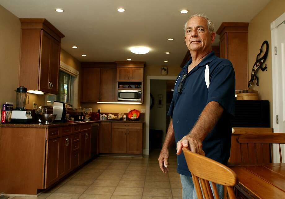 Ron Afdal, 73, shows off the different upgrades to his home such as his  new appliances and LED light fixtures, September 4, 2013, in Concord, Calif. Afdal, a retired probation officer used a lot of his retirement funds to do these major upgrades despite knowing that new home buyers won't pay extra for energy efficient  features. Photo: Lacy Atkins, The Chronicle