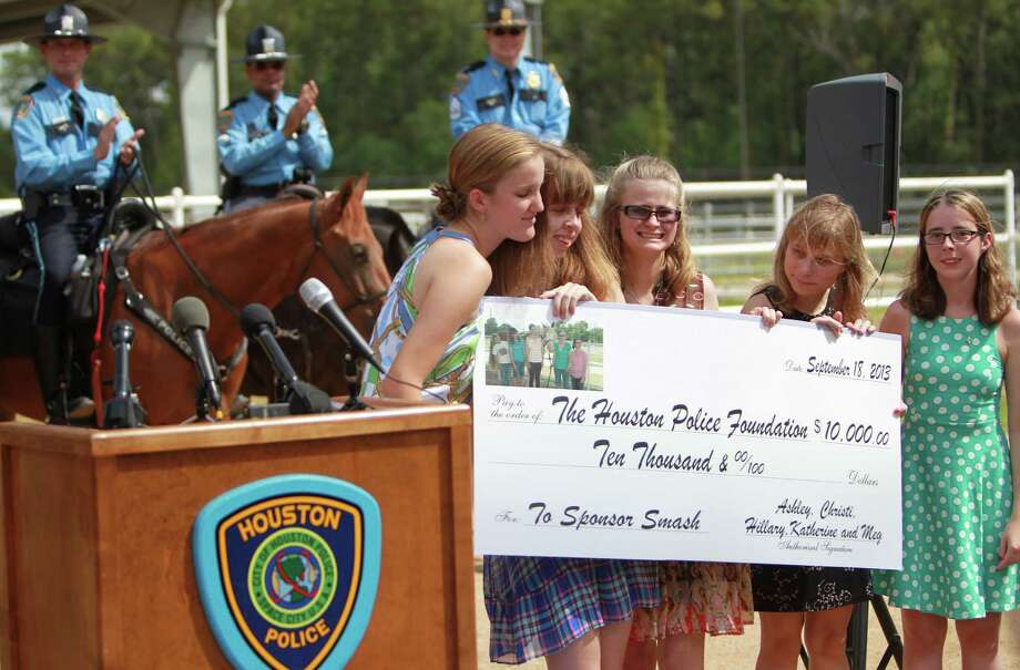 "Katherine Richards, Christi Roberts, Hillary Kern, Ashley Billard, and Meg Norman give a $10,000 check to Houston Police Foundation to sponsor ""Smash."" Photo: Mayra Beltran, Houston Chronicle / © 2013 Houston Chronicle"