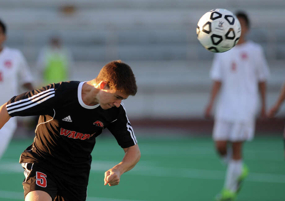 Fairfield Warde's Jack Mappa heads the ball, during boys soccer action against Central in Bridgeport, Conn. on Wednesday September 18, 2013. Photo: Christian Abraham / Connecticut Post